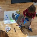 Henry painting at home